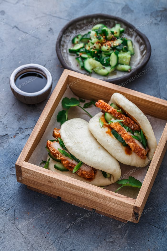 Gua bao, chinese steamed buns, with pork belly in a wooden box