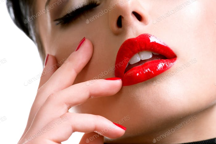 Closeup beautiful female lips with red lipstick.