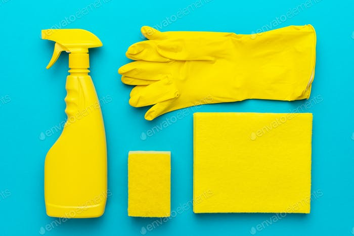 Flat Lay Image Of Yellow Cleaning Products In Order