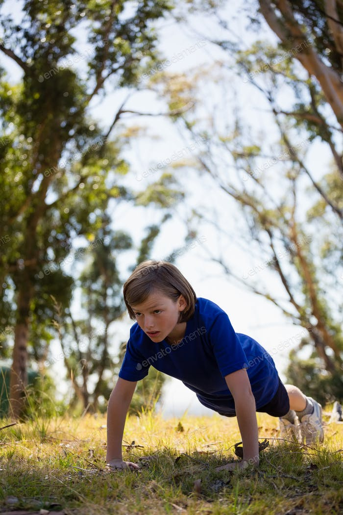 Girl exercising during obstacle course training