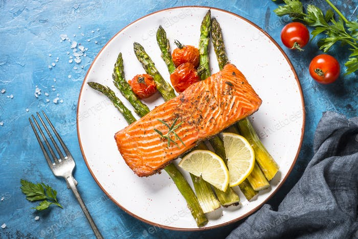 Grilled salmon fish  with asparagus and tomato.
