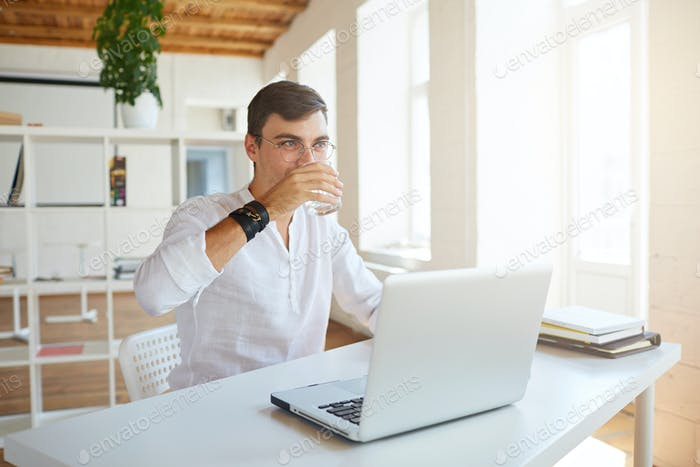 young businessman wears white shirt and spectacles working