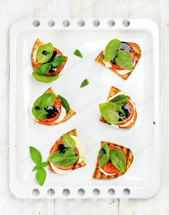 Caprese sandwiches with tomato, mozzarella cheese, basil and balsamic glaze