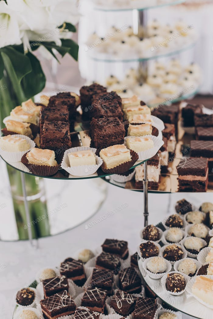 Wedding candy bar. Delicious chocolate desserts, cakes and cookies