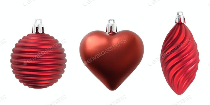 Christmas three red decorations isolated on white.