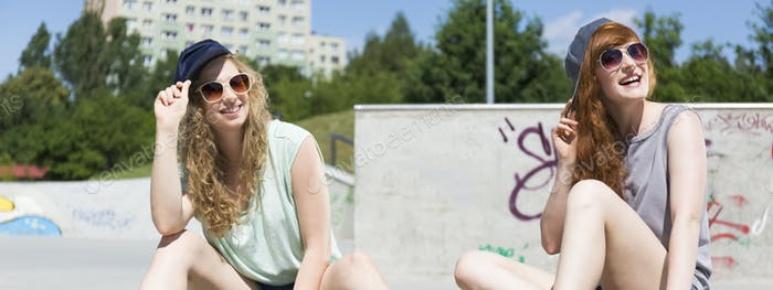 Girls sitting at the skatepark