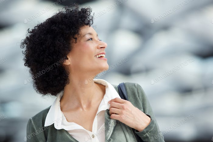 Close up attractive middle age woman laughing and looking away
