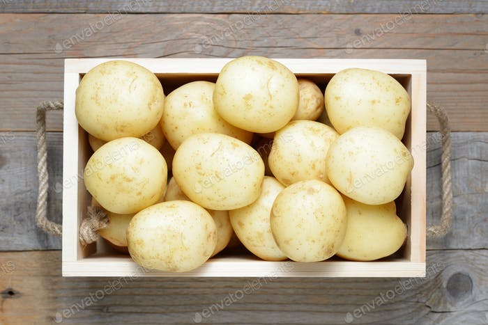 Potatoes in wooden box close-up
