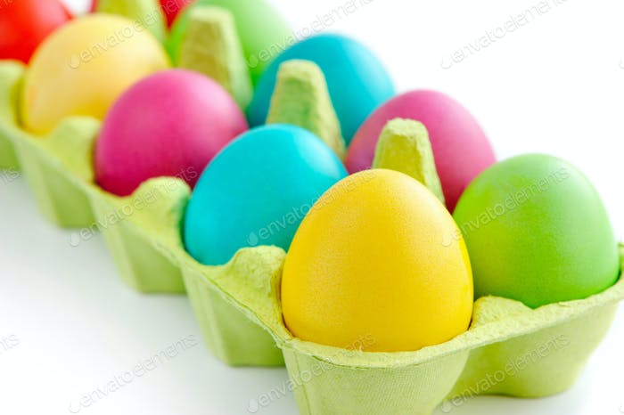 Colorful painted easter eggs inside container
