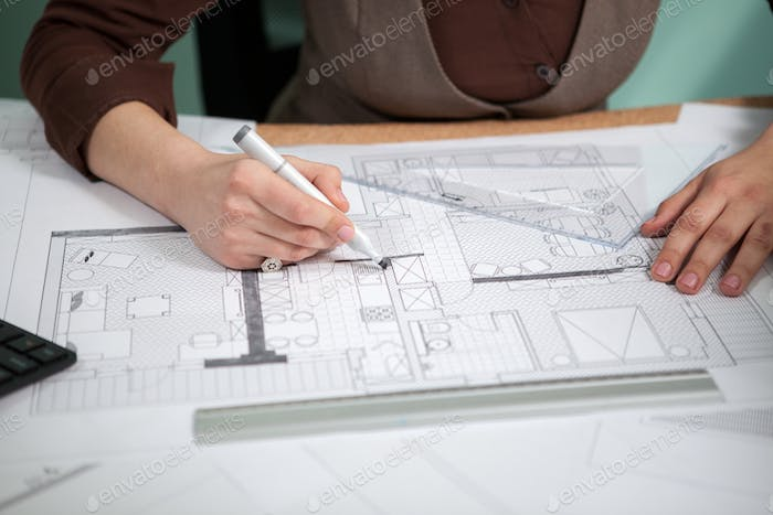 Details shot of architect blueprints on a desk