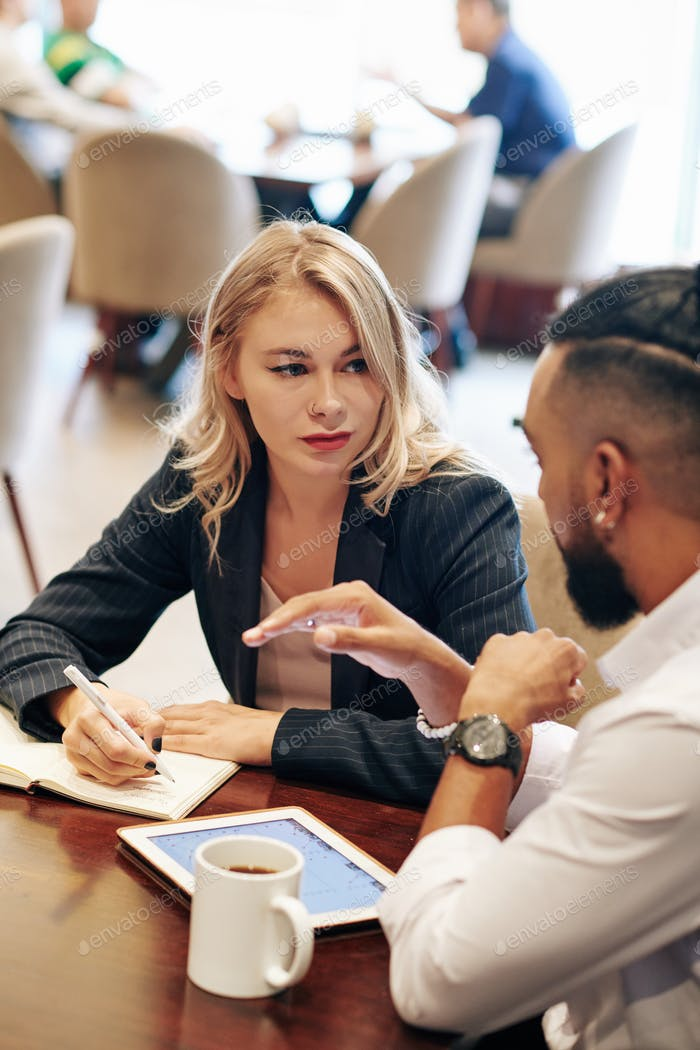 Businesswoman listening to coworker