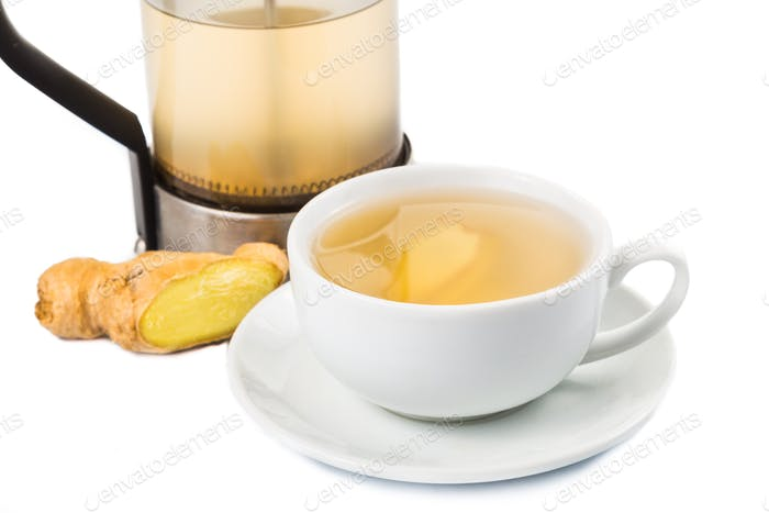 Hot ginger tea in cup with filter jar