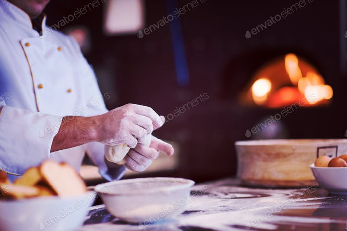 chef hands preparing dough for pizza