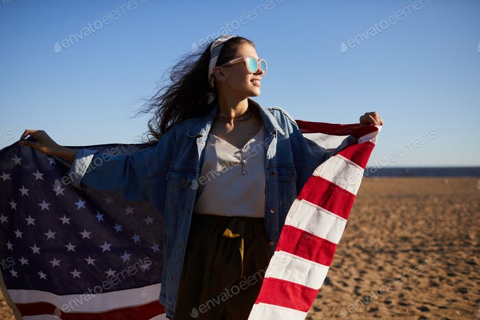 Positive carefree American girl on beach