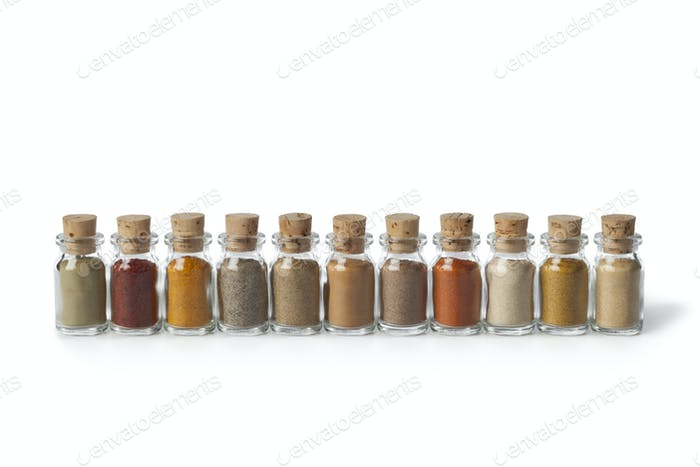 Row of glass bottles with powder herbs