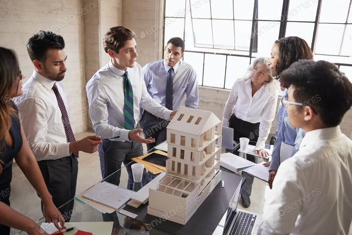 Architect presenting a design model to business colleagues