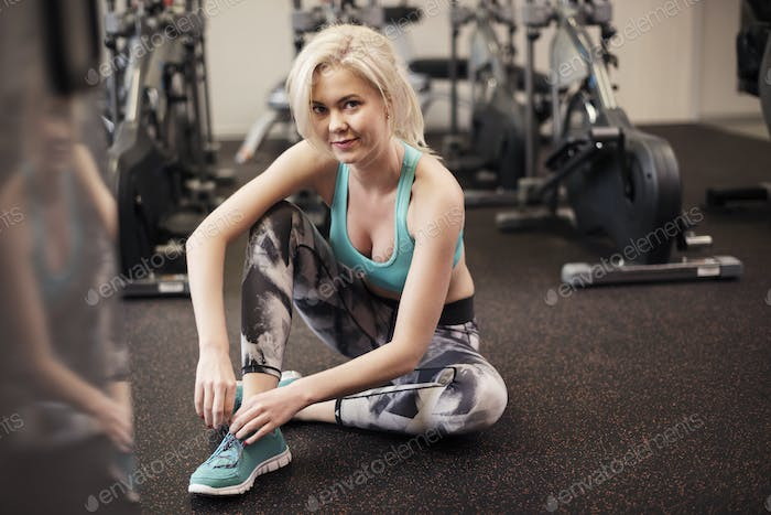 Attractive woman resting after workout