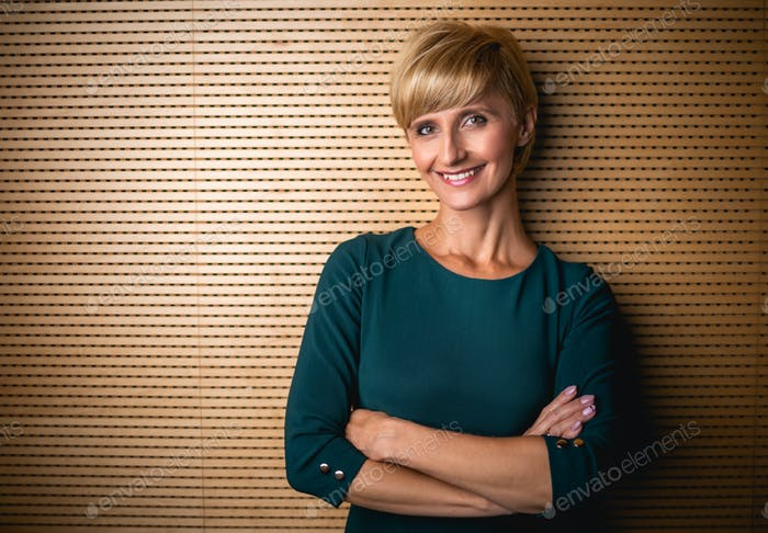 Portrait of confident mature business woman looking at camera