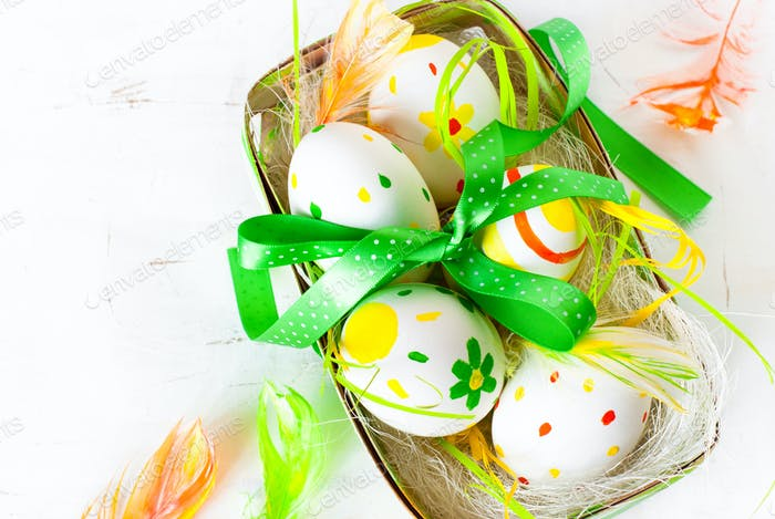 Handcrafted Easter eggs in the nest