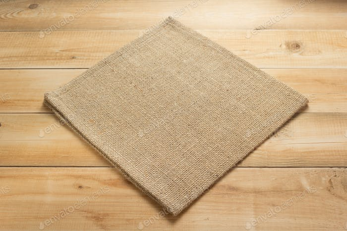burlap hessian sacking cloth on wooden background