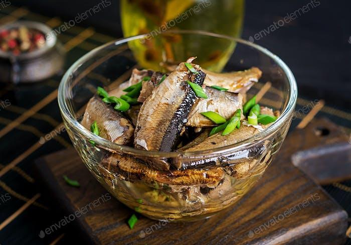 Sprats in a glass bowl. European cuisine