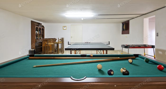 54181,Pool table and ping pong table in basement
