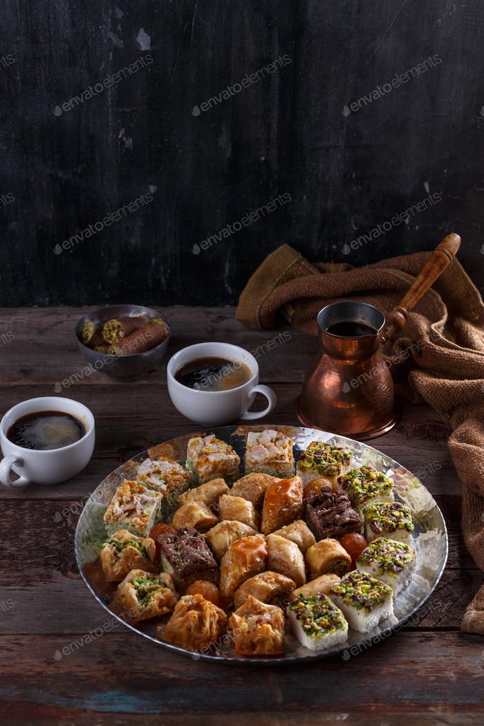 Turkish Dessert Baklava with coffee on silver tray, copy space