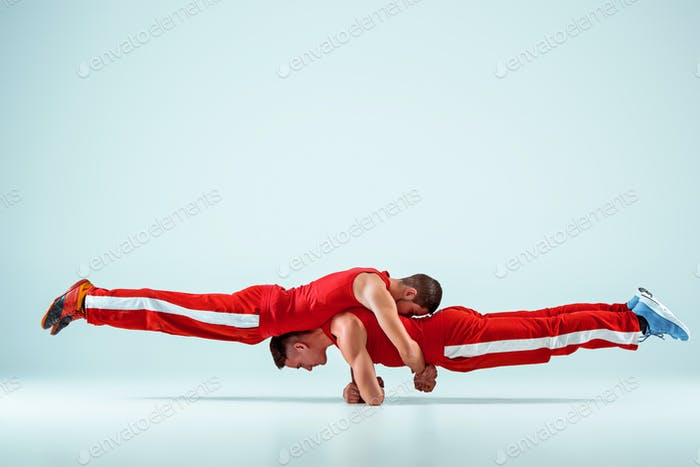 The two gymnastic acrobatic caucasian men on balance pose