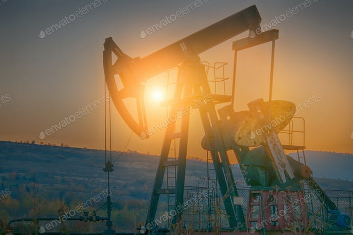 oil pump on sunset