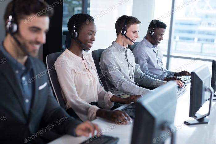 Customer service executives working at office