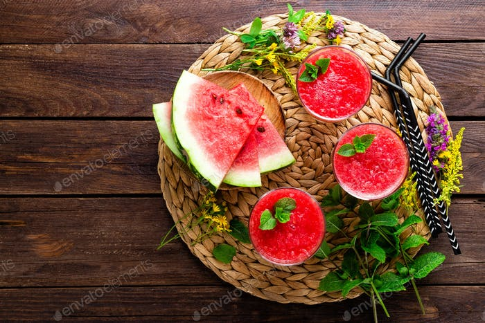 Watermelon smoothie. Watermelon drink, cocktail on wooden rustic background