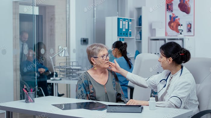 Doctor examining a patient throat