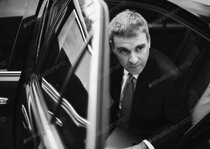 Businessman going out of his car