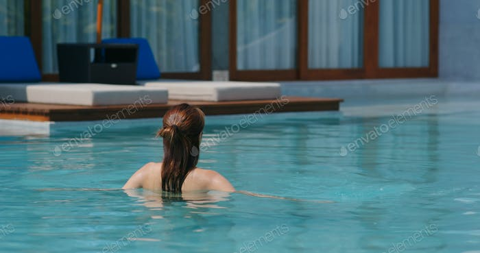 Woman swim at resort house
