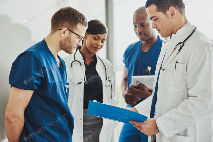 Group of doctors reading a document