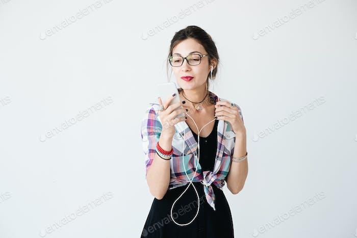 Pretty girl with phone studio shot