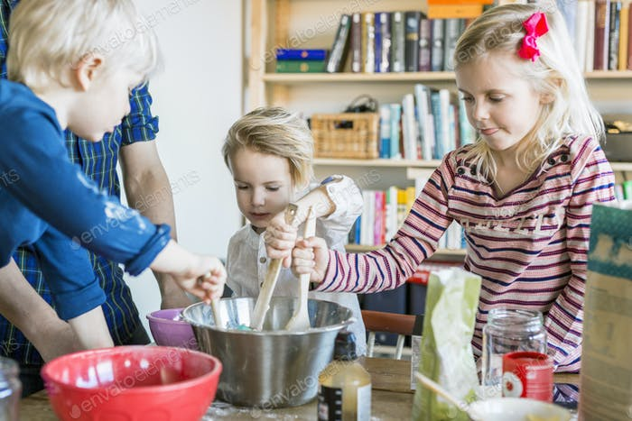 Children mixing batter at home