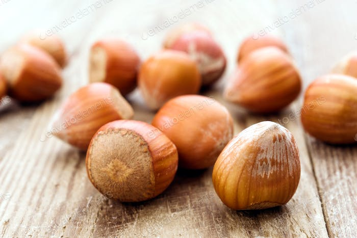 group of nuts on rustic wood