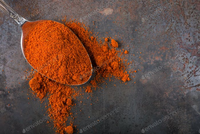 Spoon filled with paprika powder