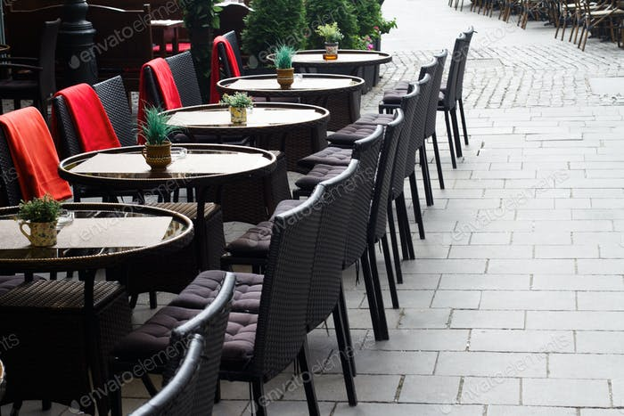 Chairs and tables on the terrace of a restaurant in the afternoo