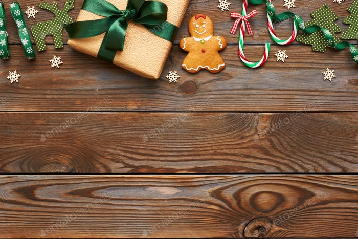 Christmas present and decoration on wooden background