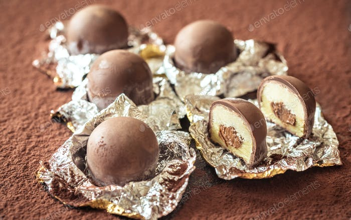 Chocolate truffles on cocoa background