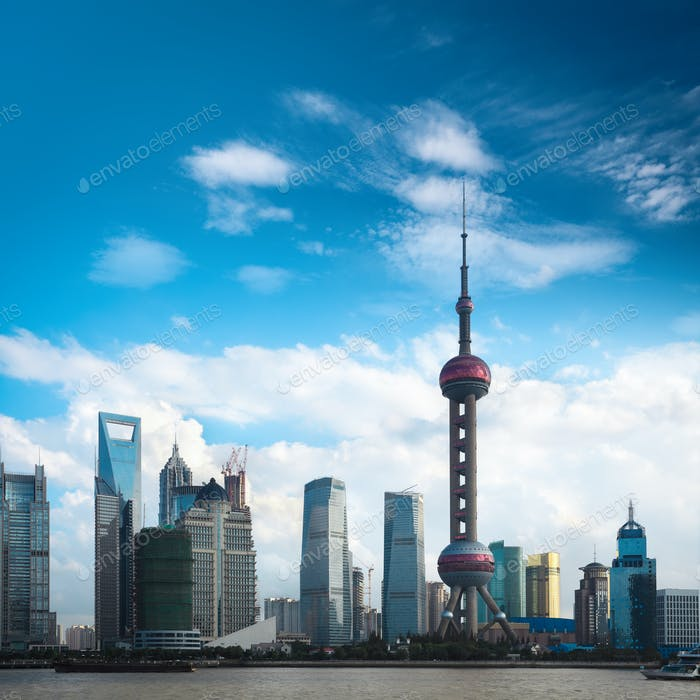shanghai skyline against a blue sky