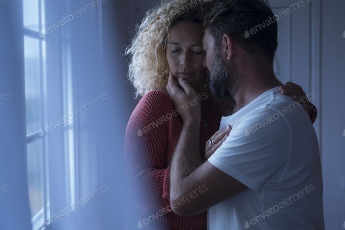 Couple and passion at home with young adult man and woman kissing and hugging in the evening