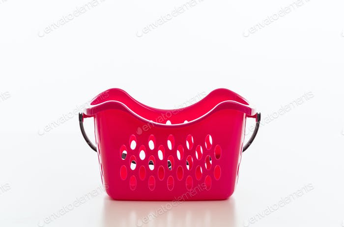 Laundry basket red color isolated against white background,