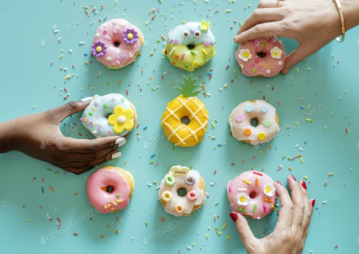 Aerial view of hands getting donut