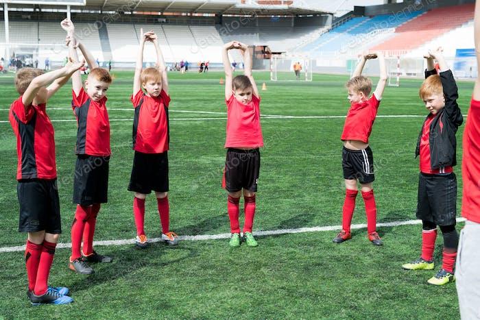 Football Team Stretching before Training