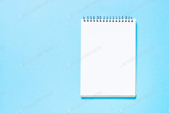 Notebook on blue top view
