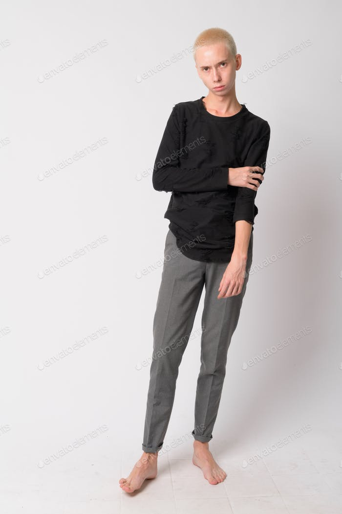 Full body shot of young handsome androgynous man