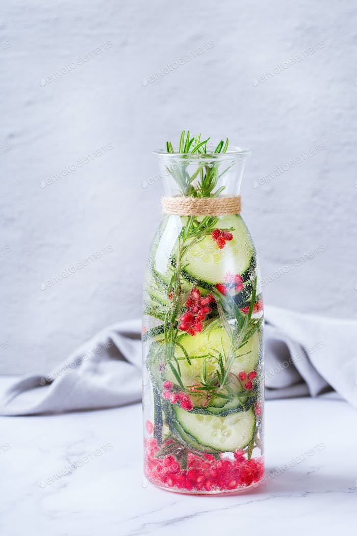 Fresh cool cucumber pomegranate infused water detox drink